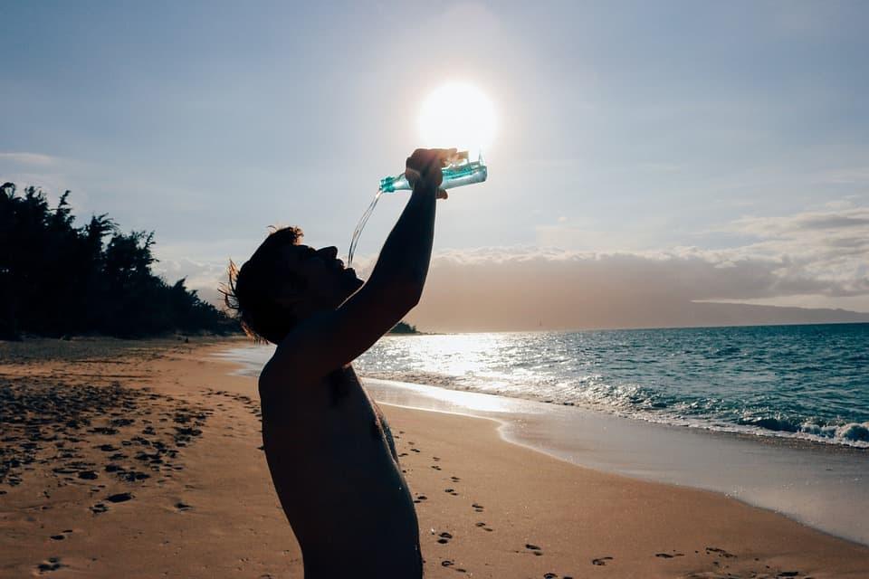 guy beach drink water